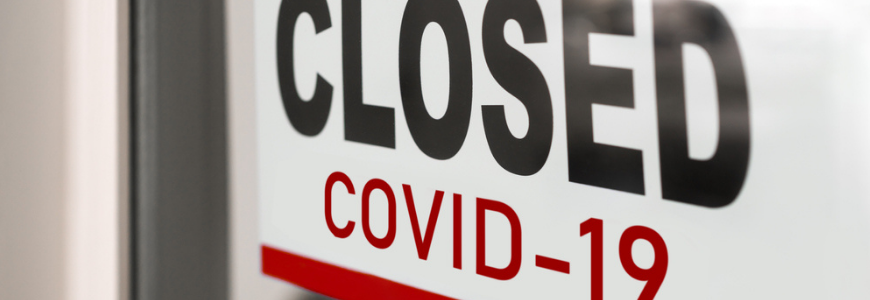 Storefront sign indicating closed due to COVID-19