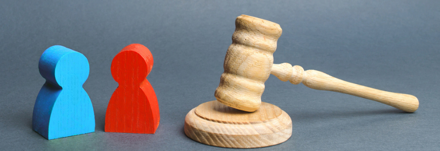 Two figures of people opponents stand near the judge's gavel.
