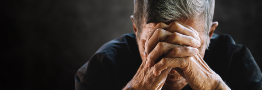 Senior man covering his face with his hands. Depression